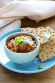 Vegetable ragout dip from eggplant and tomato with crisps — Stock Photo