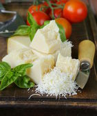 Fresh tasty hard parmesan cheese on a wooden board — Stock Photo