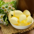 Fresh yellow dairy butter in a white bowl — Stock Photo #54654031