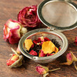 Natural organic tea from dry roses on a wooden background — Stock Photo #54748513