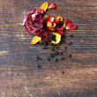 Natural organic tea from dry roses on a wooden background — Stock Photo #54748531