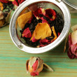 Natural organic tea from dry roses on a wooden background — Stock Photo #54748579