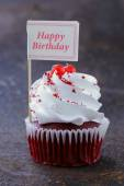Festive red velvet cupcakes with a gift compliment card — Stock Photo