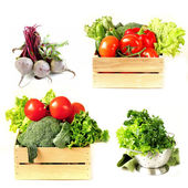 Set vegetables in wooden box, lettuce salad and beetroot on white background — Stock Photo