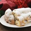Traditional Christmas stollen cake with raisins and powdered sugar — Stock Photo #56547027