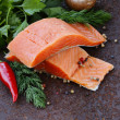 Fresh salmon (red fish) fillet with herbs, spices and vegetables - healthy food — Stock Photo #57468187