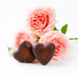 Chocolate candy in the shape of hearts and pink roses for Valentine's day holiday — Zdjęcie stockowe #58493843