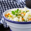 Garnish rice with various vegetables (carrots, corn and green peas) — Photo #58782053
