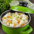 Garnish rice with various vegetables (carrots, corn and green peas) — Photo #58782101