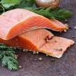 Fresh salmon (red fish) fillet with herbs, spices and vegetables - healthy food — Stock Photo #59263883