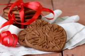 Chocolate cookies in the shape of heart, symbol of love — Stock Photo