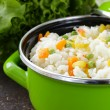 Garnish rice with various vegetables (carrots, corn and green peas) — Stock Photo #59689007