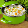 Garnish rice with various vegetables (carrots, corn and green peas) — Photo #59689055