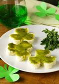 Funny sandwiches in the form of clover with green cheese Patrick's Day food — Stock Photo