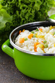 Garnish rice with various vegetables (carrots, corn and green peas) — Stock Photo