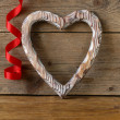 Wooden heart symbol of love on the old background — Stock Photo #61607191