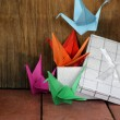 Colorful paper origami birds crane Japanese symbol — Stock Photo #62221905