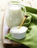 Milk and sour cream on a wooden table, rustic style — Foto de Stock