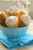 Sweet wafer cone filled with vanilla cream — Stock Photo