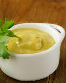 Natural mustard sauce in a white bowl — Stock Photo