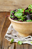 Mix salad (arugula, iceberg, red beet) in a wooden bowl — Stock Photo