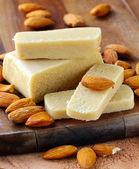 Marzipan almonds bar  bread , wish fresh almond on a wooden board — Stock Photo
