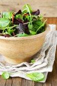 Mix salad (arugula, iceberg, red beet) in a wooden bowl — Stok fotoğraf