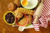 Ingredients for baking desserts cookies, muffins, waffles on a wooden table — Stock Photo