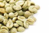 Organic green coffee beans close-up, healthy food — Stock Photo