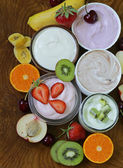 Assortment of different yogurt for breakfast with berries and fruits — Stock Photo