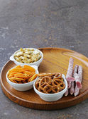 Various salty snacks - crackers, chips, nuts, pretzels — Stock Photo