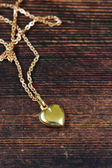 Gold jewelry - necklace chain with heart — Stock Photo