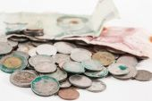 Dirty coins and old banknote — Stock Photo
