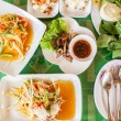 Papaya salad (som tum Thai) with sticky rice and grilled beef — Stock Photo #57501967