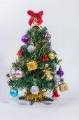 Decorated Christmas tree on white paper background — Stock Photo