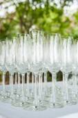 Row of water glasses on the table — Stock Photo