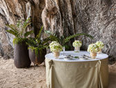 Floral arrangement at a wedding ceremony on the beach. — Stock Photo