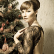 Beautiful woman with Christmas tree- vintage card — Stock Photo #56567889