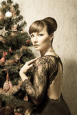 Beautiful woman with Christmas tree- vintage card — Stock Photo