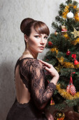 Beautiful woman with Christmas tree — Stock Photo
