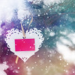 Snowy background with white Valentines lace heart with card — Stock Photo #63151169