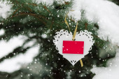 White Valentines lace heart with card on the snow fir tree — Stock Photo