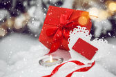 White Valentines heart and gift box on the snow — Stock Photo