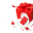 Isolated red gift box with Valentines card — Stock Photo #63221741