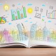 Drawing of a business scheme on an opened book — Stock Photo