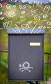 Postbox with white hand drawn mail icons — Stock Photo