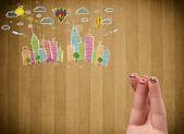 Glad smiley fingrar tittar på färgglada handrawn stadsbild — Stockfoto