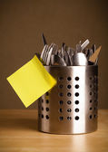 Empty post-it note sticked on cutlery case — Stock Photo