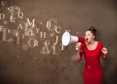 Young girl shouting into megaphone and text come out — Stock Photo