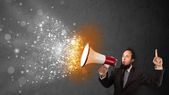 Guy shouting into megaphone and glowing energy particles explode — Stock Photo